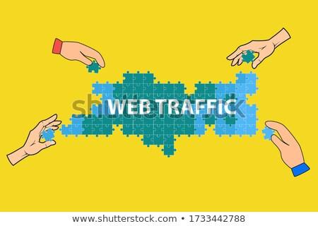 web traffic concept on green puzzle pieces stock photo © tashatuvango