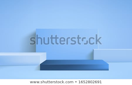 Pedestal of white cubes on a blue background Stock photo © cherezoff