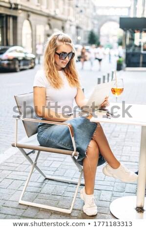 Bella ragazza bere terrazza Foto d'archivio © nenetus