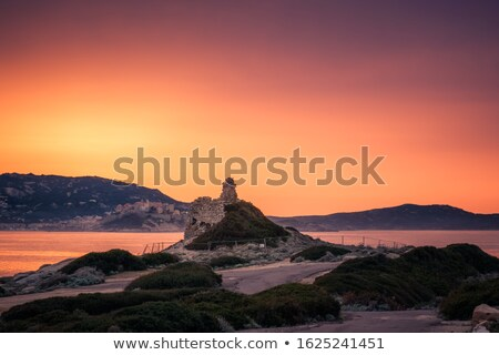 ストックフォト: 塔 · コルシカ島 · 日没 · 海 · 青 · 山