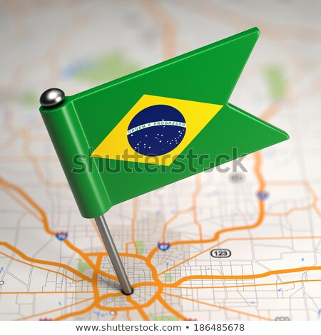 Brazil Small Flag on a Map Background. Stock photo © tashatuvango