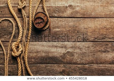 Wood texture with marine knot and compass Stock photo © yelenayemchuk