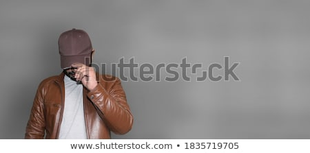 young man wearing leather jacket stock photo © stockyimages