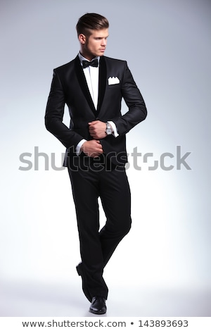 fashion man in tuxedo looking to his side Stock photo © feedough