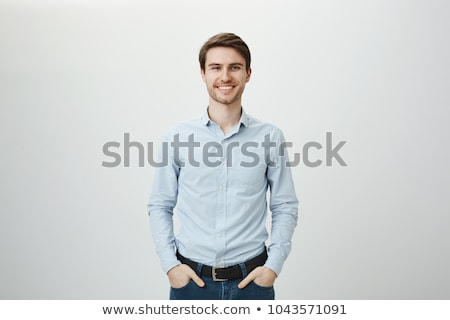 man in blue shirt pointing stock photo © feedough