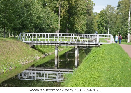 Bridge over channel in the park Stock photo © amok