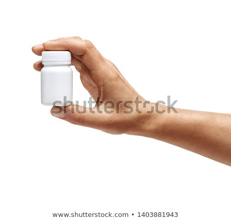 Man hand holding pill isolated stock photo © entazist