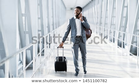 Man at the Airport with Suitcase Stock photo © HASLOO
