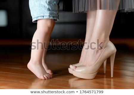 Businesswoman standing barefoot on her toes Stock photo © cherezoff
