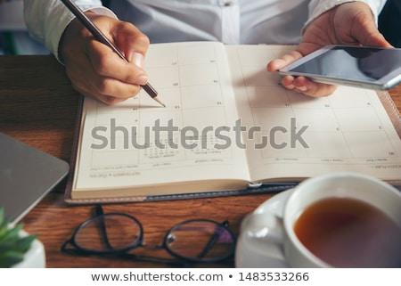 biznesmen · kalendarza · posiedzenia · biurko · planowania - zdjęcia stock © nyul