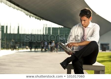 Elegáns üzletember ül lábak keresztbe oldalnézet kép Stock fotó © feedough