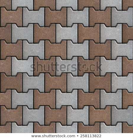 Brown and Gray Pavement Consisting of Geometric Shapes. Stock photo © tashatuvango