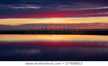 Blue and red sunset in Kalajoki reflecting in sea Stock photo © miracky