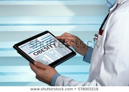 Otyłość Widok medycznych tabletka diagnoza czarny Zdjęcia stock © tashatuvango