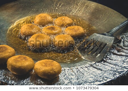patty frizzle in frying pan Stock photo © Mikko