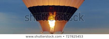 Flames from a burner inside a hot-air balloon envelop Stock photo © Balefire9
