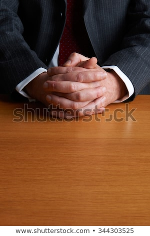 sitting twiddling ones thumbs stock photo © istanbul2009