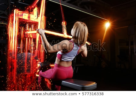 Woman training with  fiery dumbbells Stock photo © alphaspirit