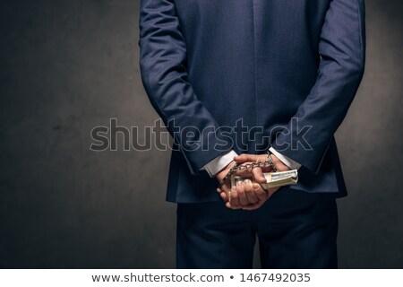 businessman in handcuffs holding bribe Stock photo © wavebreak_media