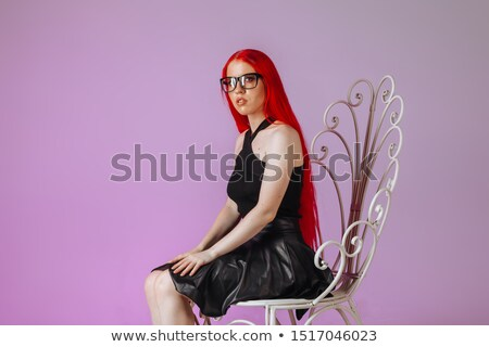 attractive rocker woman in leather posing seated in studio  Stock photo © feedough
