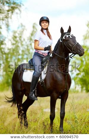 Happy Female Jockey Smiling Stock photo © NicoletaIonescu