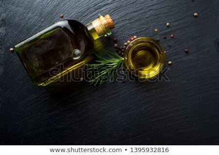 Rosemary infused olive oil Stock photo © marimorena