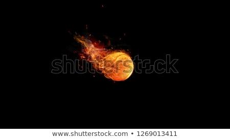 Flaming tennis ball on black Stock photo © bluering