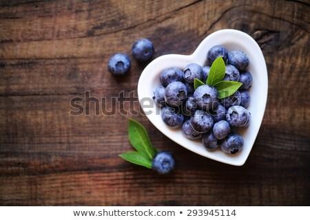 Wicker heart and berries Stock photo © hraska