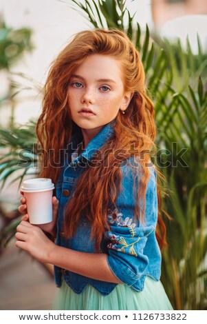 Mulher longo cabelos cacheados em pé olhando câmera Foto stock © deandrobot