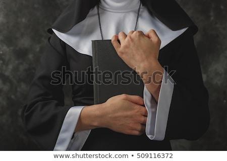 the religious nun in religion concept against dark background stock photo © elnur
