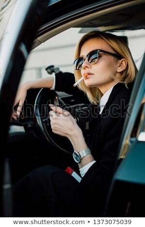 Mujer fumar cigarrillo coche aparcamiento hermosa Foto stock © deandrobot