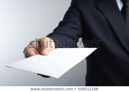 üzletember · levél · ül · asztal · ikon · kéz - stock fotó © shawnhempel