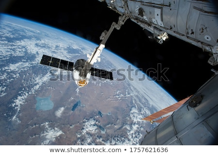 Cargo ship over Earth with Moon stock photo © sebikus