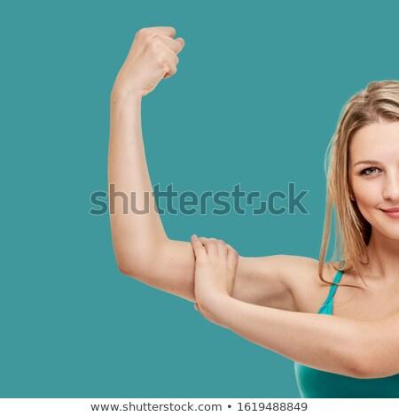 aerobic woman showing biceps stock photo © deandrobot