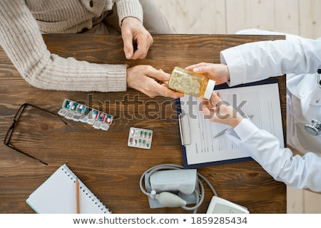 Stockfoto: Doctor With Tonometer And Senior Woman At Hospital