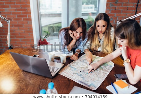 Three students study geography in class Stock photo © bluering