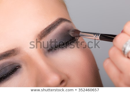 Stock photo: The woman getting make-up isolated on white