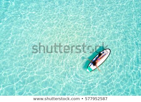 Szörfös lány trópusi tengerpart sétál tengerpart nap Stock fotó © alphaspirit