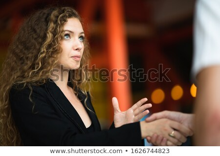 Young pretty woman says goodbye to her men Stock photo © konradbak