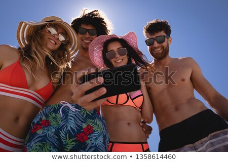 low angle view of young friends taking selfie against clear sky stock photo © wavebreak_media