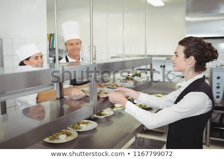 повар продовольствие блюдо официантка порядка станция Сток-фото © wavebreak_media