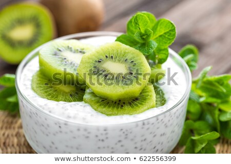 Fresh kiwi yogurt with fruits and chia seeds, healthy breakfast Stock photo © yelenayemchuk