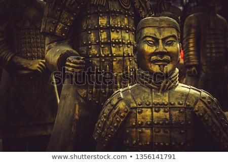 Estatueta antigo guerreiro metal isolado branco Foto stock © restyler