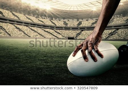 Cropped image of athlete holding rugby ball Stock photo © wavebreak_media