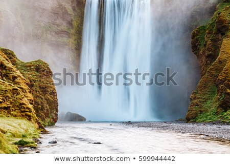 Lovely view of famous Skogafoss waterfall and scenic surrounding Stock photo © Leonidtit