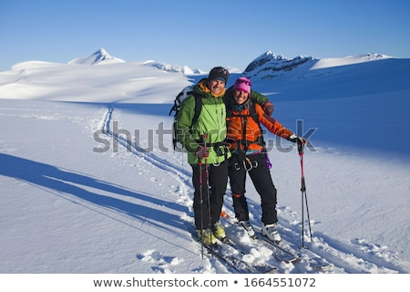 woman and man with ski gear at hut Stock photo © IS2