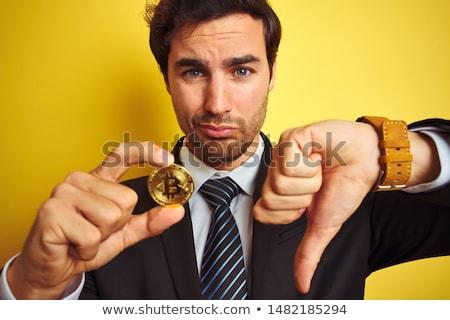 Man showing Bitcoin Stock photo © stevanovicigor