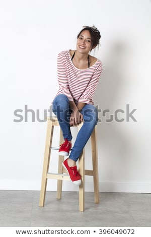 Laughing Woman Sitting on the Stool Stock photo © filipw