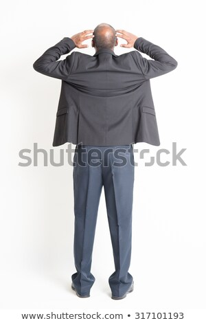 rear view of a stressed businessman with hand on head stock photo © andreypopov