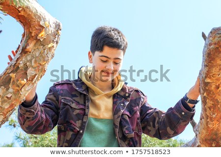 Teenage boy looking down Stock photo © monkey_business